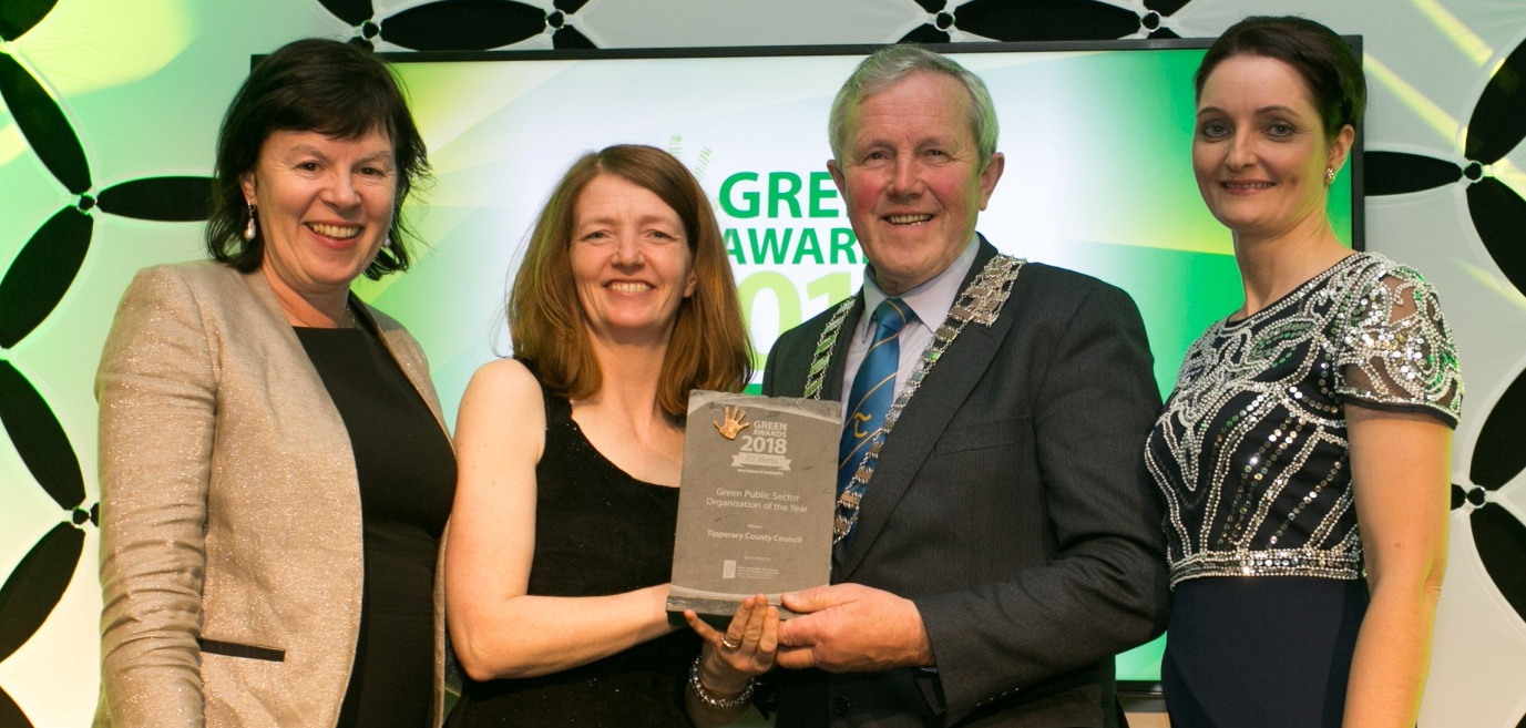 Bernie Kiely, Assistant Principal in the Waste and Resource Efficiency Division, Department of Communications, Climate Action & Environment, presents the Green Public-Sector Organisation of the Year award to Marion O'Neill, Roger Kennedy and Paula Gallagher, Tipperary County Council.