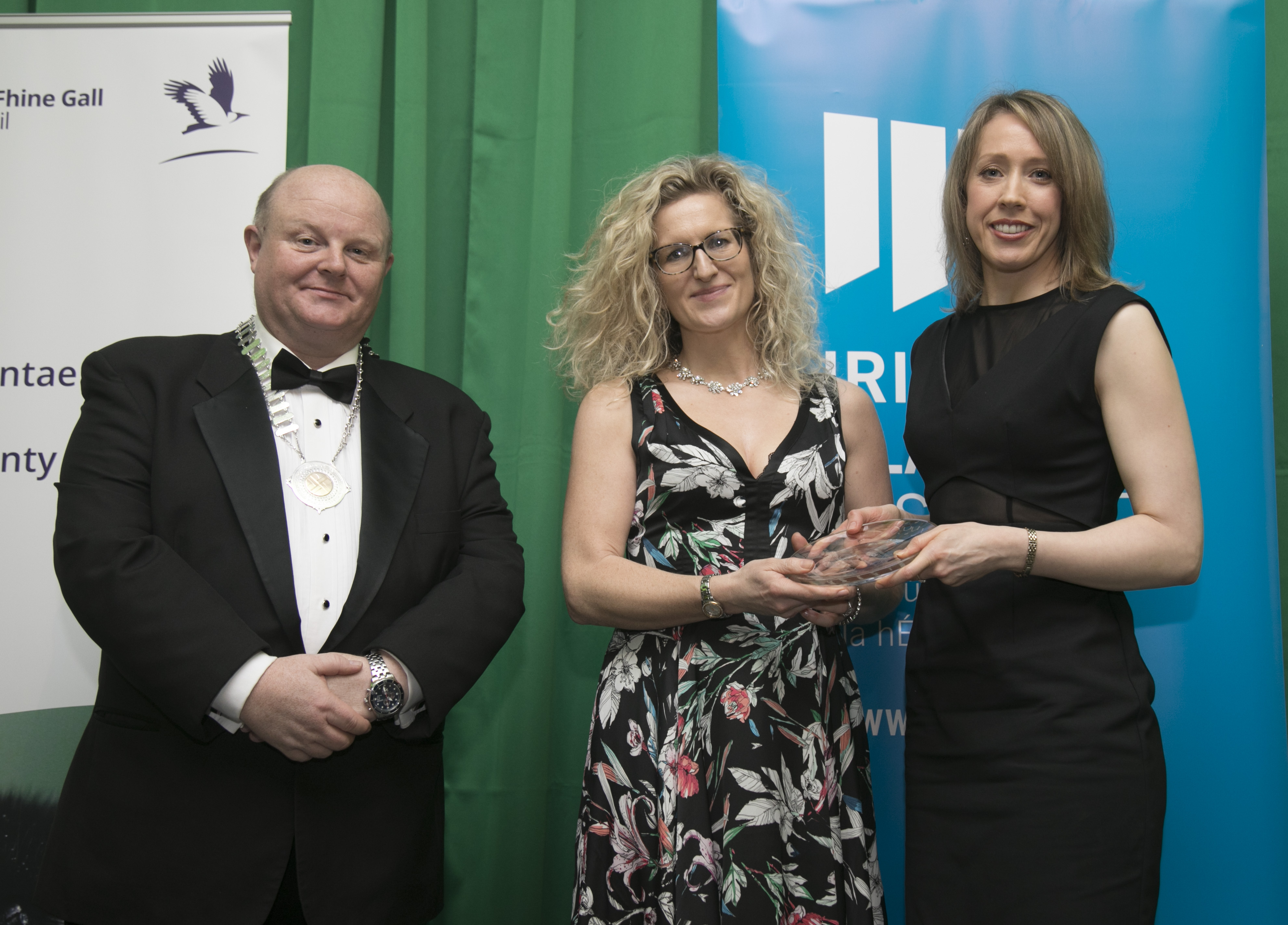 Clare Lee, Planning Section, receiving 'President's Award' award from outgoing Irish Planning Institute President, Deidre Fallon, with new President Joe Corr.